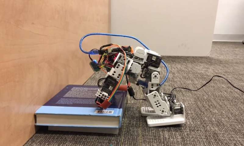 Engineer teaching humanoid robots to use their hands to stop themselves from falling